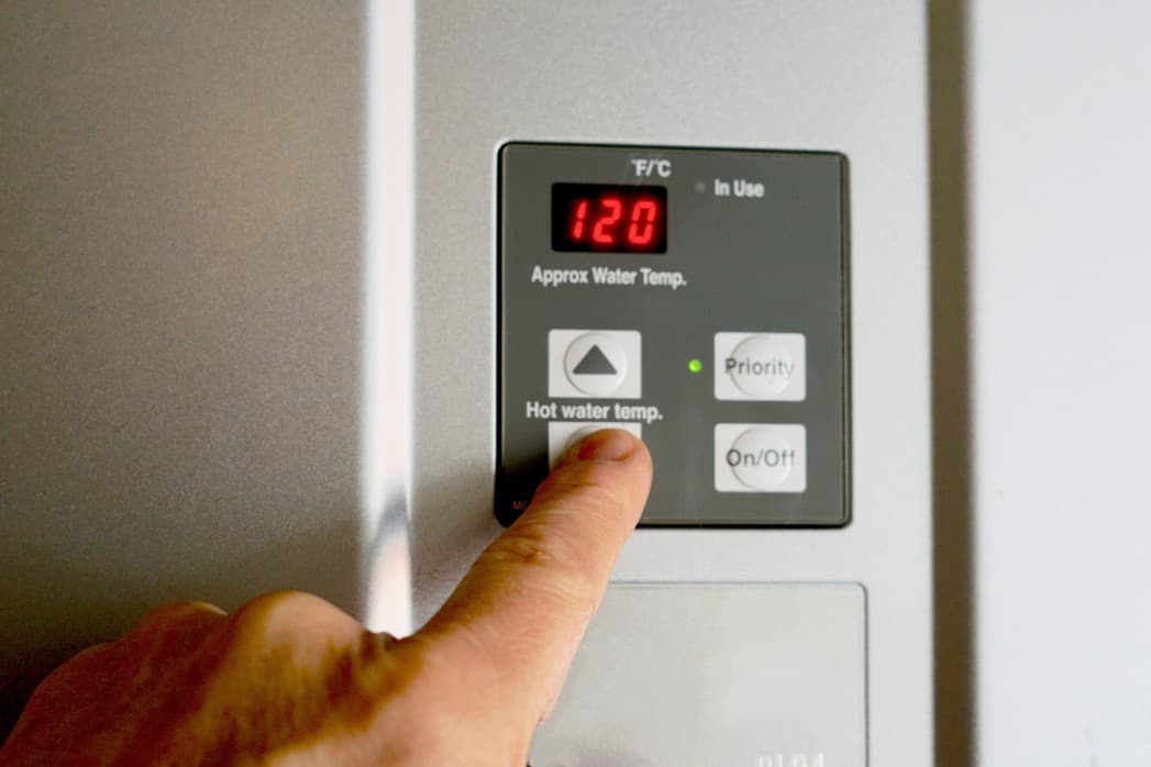 adjust the water heater temperature to save energy